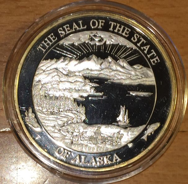 THE SEAL OF THE STATE OF ALASKA EAGLE AGUILA