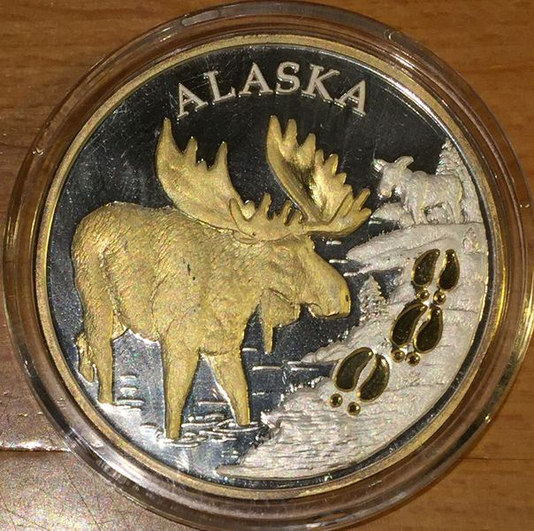 THE SEAL OF THE STATE OF ALASKA MOOSE ALCE